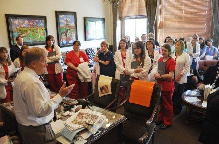 House Republican leader Tom Cross greeted a large group of nurses in his office.