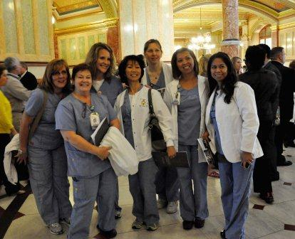 Laurie Riek, left, and fellow nurses from Advocate Condell pose for a photo.