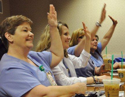 Nearly 80 Advocate Health Care nurses attended a briefing before heading out to talk with legislators.