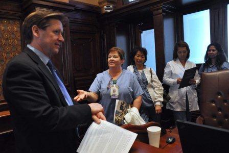 Senator Dan Duffy chats with Laurie Riek and fellow nurses.