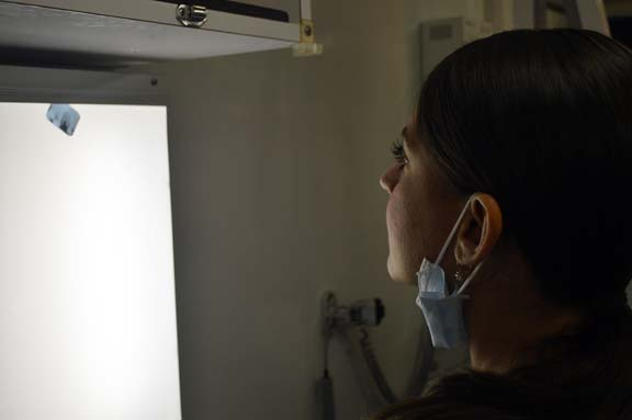 Dr. Ann Marie Maggio, attending dentist, takes a look at a patient's X-ray.