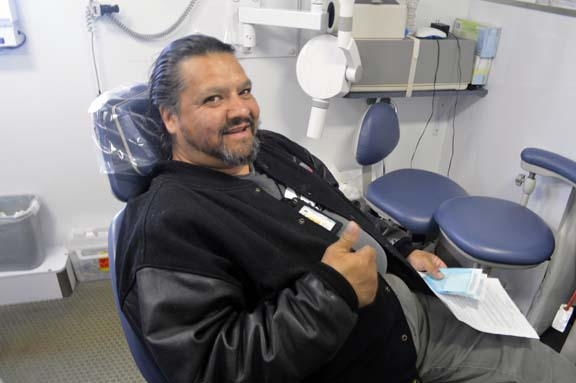 """""""That's the best thing about this job—watching people leave happy,"""" says Omar Abarca, dental assistant and driver."""