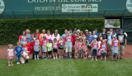 Pediatric patients play catch at Wrigley Field