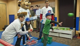 Cubs' new mascot and rookies visit young fans