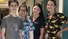 Teen still bonded with his health care heroes long after life-saving treatment